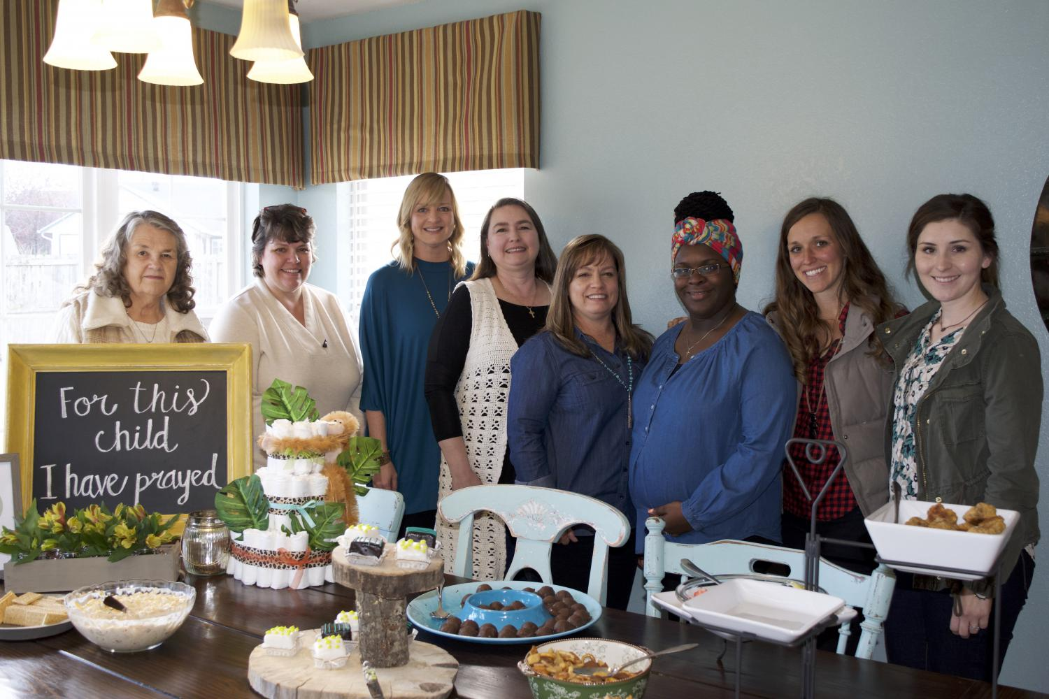 Kendra Arnolds with Ladies from her group at the Baby Shower for Rico Jr.